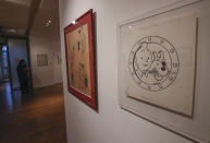 The Chinese inked on paper original of the comic character Tintin and his dog snowy as a pirate made for an advertising and drawn by Belgian creator Herge, is displayed at the Artcurial auction house in Paris, Wednesday, Jan. 13, 2021. The art work with an estimates value of 2.2 to 2.8 million euros (US $ 3650 to 6080), is going on sale Thursday. (AP Photo/Michel Euler)