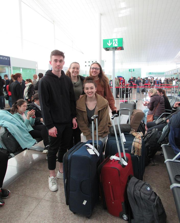 Graydon Scofield-Swartz, left, Erin Aufrichtig, front, and friends at Barcelona's airport after a nine-hour ordeal to find flights back to the U.S. (Melissa Rossi for Yahoo News)
