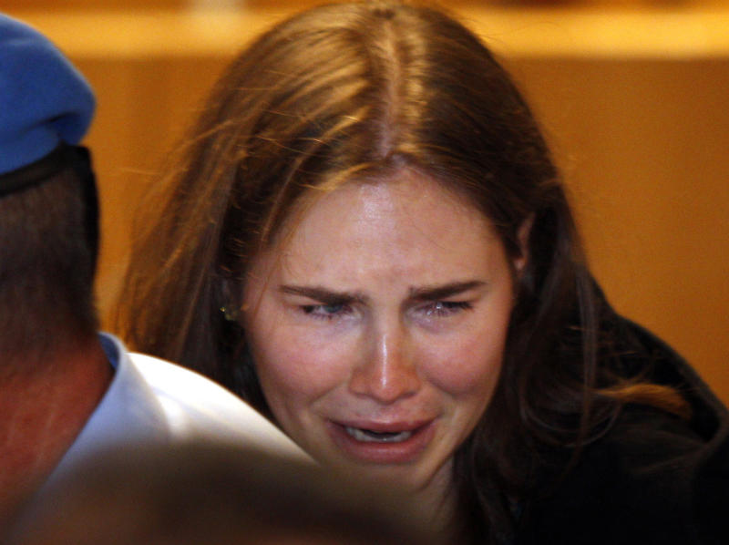 FILE - In this Oct. 3, 2011 file photo, Amanda Knox breaks in tears after hearing the verdict that overturns her conviction and acquits her of murdering her British roommate Meredith Kercher. On Tuesday, June 18, 2013, Italy's high court has explained why it reversed the acquittal of American student Amanda Knox, saying the decision acquitting her of murder was full of contradictions. In March, 2013, the Court of Cassation overturned Knox's acquittal in the 2007 murder of flatmate Meredith Kercher and ordered a new trial. (AP Photo/Pier Paolo Cito)
