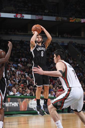 MILWAUKEE, WI - FEBRUARY 20: Deron Williams #8 of the Brooklyn Nets shoots a three-pointer against the Milwaukee Bucks on February 20, 2013 at the BMO Harris Bradley Center in Milwaukee, Wisconsin. (Photo by Gary Dineen/NBAE via Getty Images)