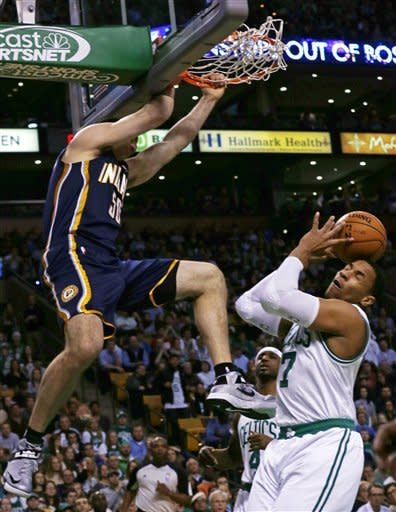 Indiana Pacers forward Tyler Hansbrough, left, dunks over Boston Celtics forward Jared Sullinger, right, during the first quarter of an NBA basketball game in Boston, Friday, Jan. 4, 2013. (AP Photo/Charles Krupa)