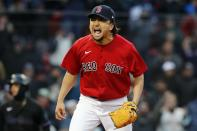 Boston Red Sox's Hirokazu Sawamura reacts after striking out Miami Marlins' Jose Devers to retire the side during the eighth inning of a baseball game, Saturday, May 29, 2021, in Boston. (AP Photo/Michael Dwyer)
