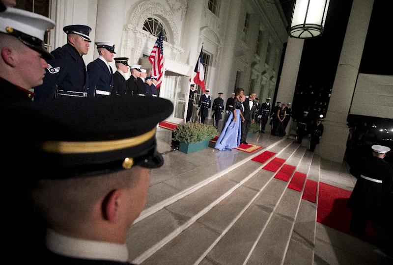 First lady Michelle Obama, left, and President Barack Obama welcome French President François Hollande for a State Dinner at the North Portico of the White House on Tuesday, Feb. 11, 2014, in Washington.(AP Photo/ Pablo Martinez Monsivais)