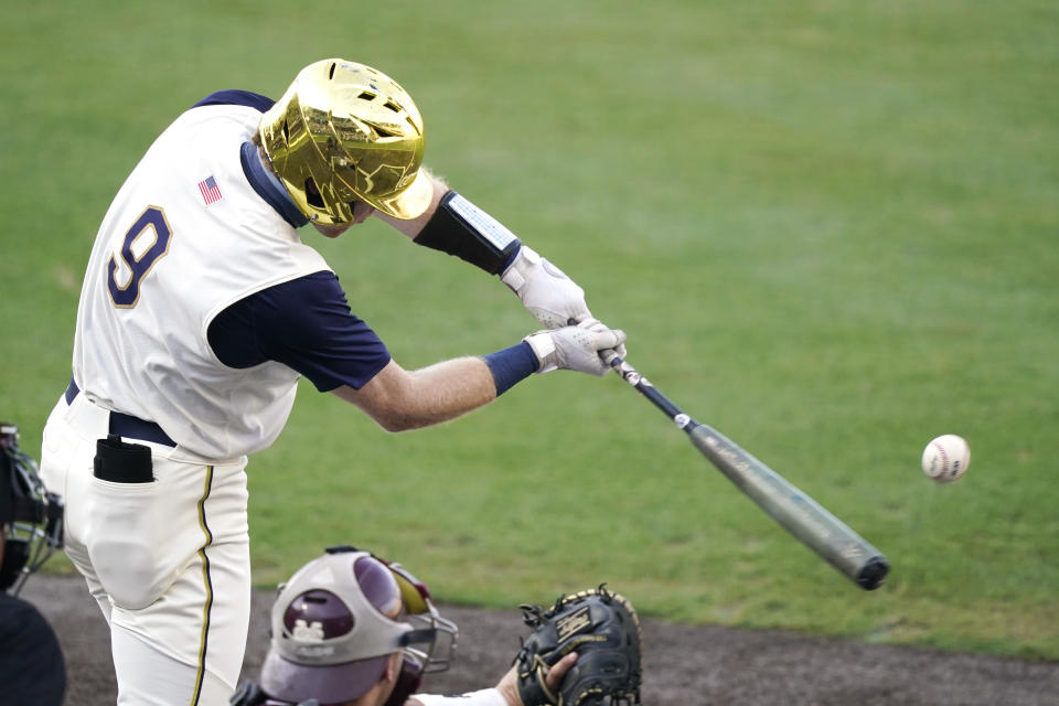Notre Dame's Jack Brannigan (9) reaches out to hit a Mississippi State pitch during an NCAA college baseball super regional game, Monday, June 14, 2021, in Starkville, Miss. (AP Photo/Rogelio V. Solis)