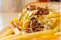 "<p><strong>Philly Cheesesteak</strong></p><p>This one is a no-brainer. A visit to Philly isn't a proper one without trying a proper Philly Cheesesteak. We know, we know, <a href=""https://www.genosteaks.com/"" rel=""nofollow noopener"" target=""_blank"" data-ylk=""slk:Geno's"" class=""link rapid-noclick-resp"">Geno's</a> or <a href=""https://www.patskingofsteaks.com/"" rel=""nofollow noopener"" target=""_blank"" data-ylk=""slk:Pat's"" class=""link rapid-noclick-resp"">Pat's</a>? Here's a secret -- both iconic restaurants are amazing, but this friendly camaraderie probably boosts sales for both. </p>"