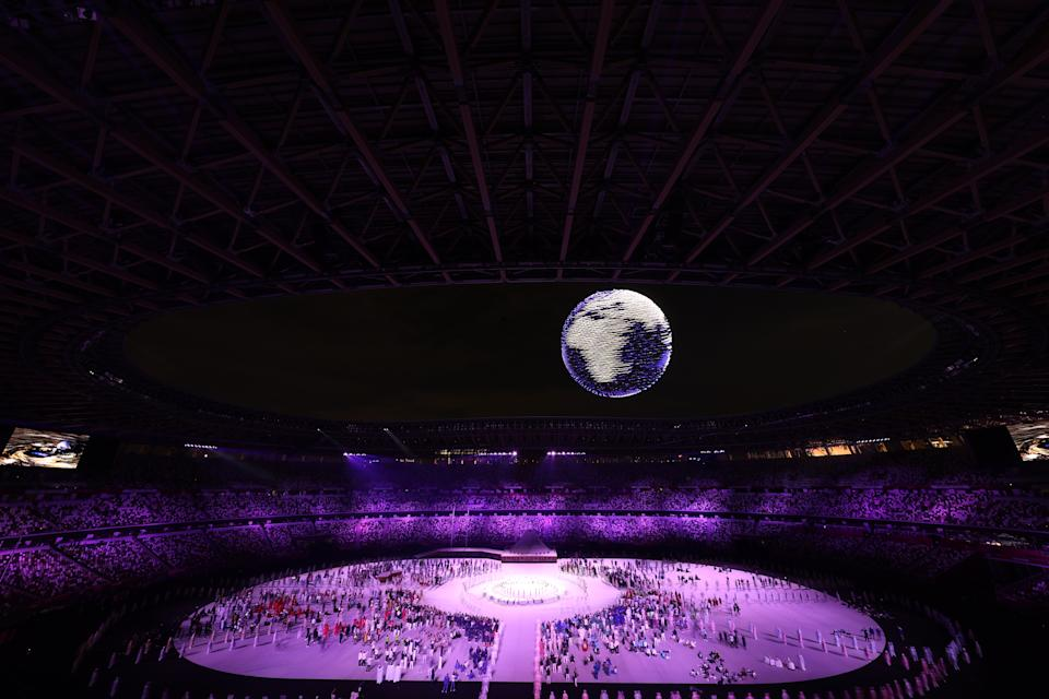 TOKYO, JAPAN - JULY 23: A drone display is seen over the top of the stadium during the Opening Ceremony of the Tokyo 2020 Olympic Games at Olympic Stadium on July 23, 2021 in Tokyo, Japan. (Photo by Laurence Griffiths/Getty Images)