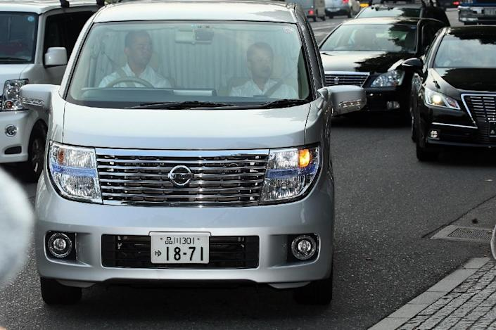 A van carrying Mark Karpeles (not in picture), former CEO of MtGox Bitcoin exchange, arrives at a police station in Tokyo on August 1, 2015 (AFP Photo/)