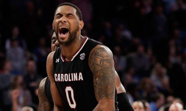 South Carolina guard Sindarius Thornwell (0) reacts after dunking the ball against Florida. (AP)