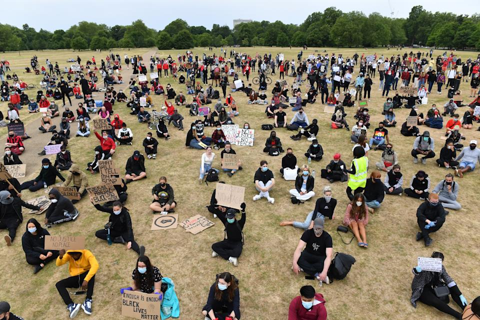 People observe social distancing as they participate in a Black Lives Matter protest rally in Hyde Park, London, in memory of George Floyd who was killed on May 25 while in police custody in the US city of Minneapolis. (Photo by Dominic Lipinski/PA Images via Getty Images)