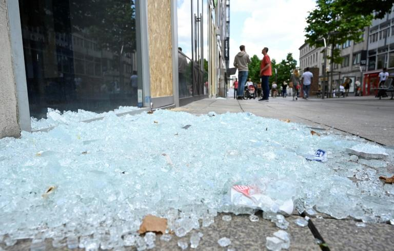 In all, nine shops were looted while 14 others suffered damage such as broken windows (AFP Photo/THOMAS KIENZLE)