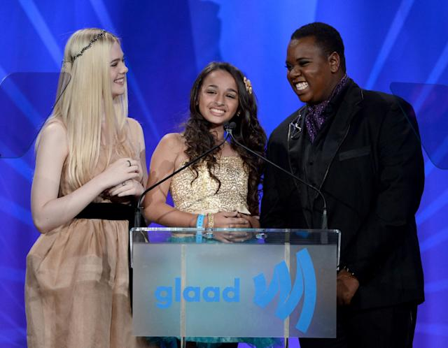 Jazz Jennings, at 13, flanked by Elle Fanning and Alex Newell onstage during the 24th Annual GLAAD Media Awards in Los Angeles in 2013. (Photo: Kevin Winter/Getty Images for GLAAD)