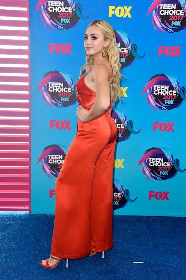 <p>The <i>Diary of a Wimpy Kid</i> actor styled her blond locks loose, showing a bare back in a bright red silk jumpsuit. (Photo: Getty Images) </p>