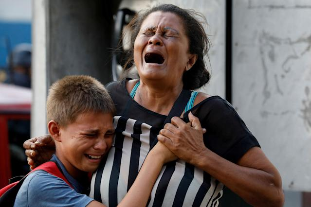 <p>Relatives of inmates held at the General Command of the Carabobo Police react as they wait outside the prison, where a fire occurred in the cells area, according to local media, in Valencia, Venezuela, March 28, 2018. (Photo: Carlos Garcia Rawlins/Reuters) </p>