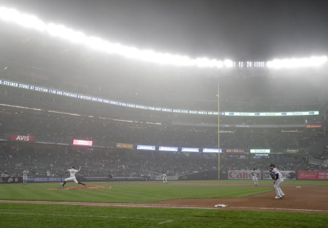 New York Yankees pitcher Chad Green (57) delivers against the Minnesota Twins as fog hangs over Yankee Stadium during the fifth inning of a baseball game, Wednesday, April 25, 2018, in New York. (AP Photo/Julie Jacobson)