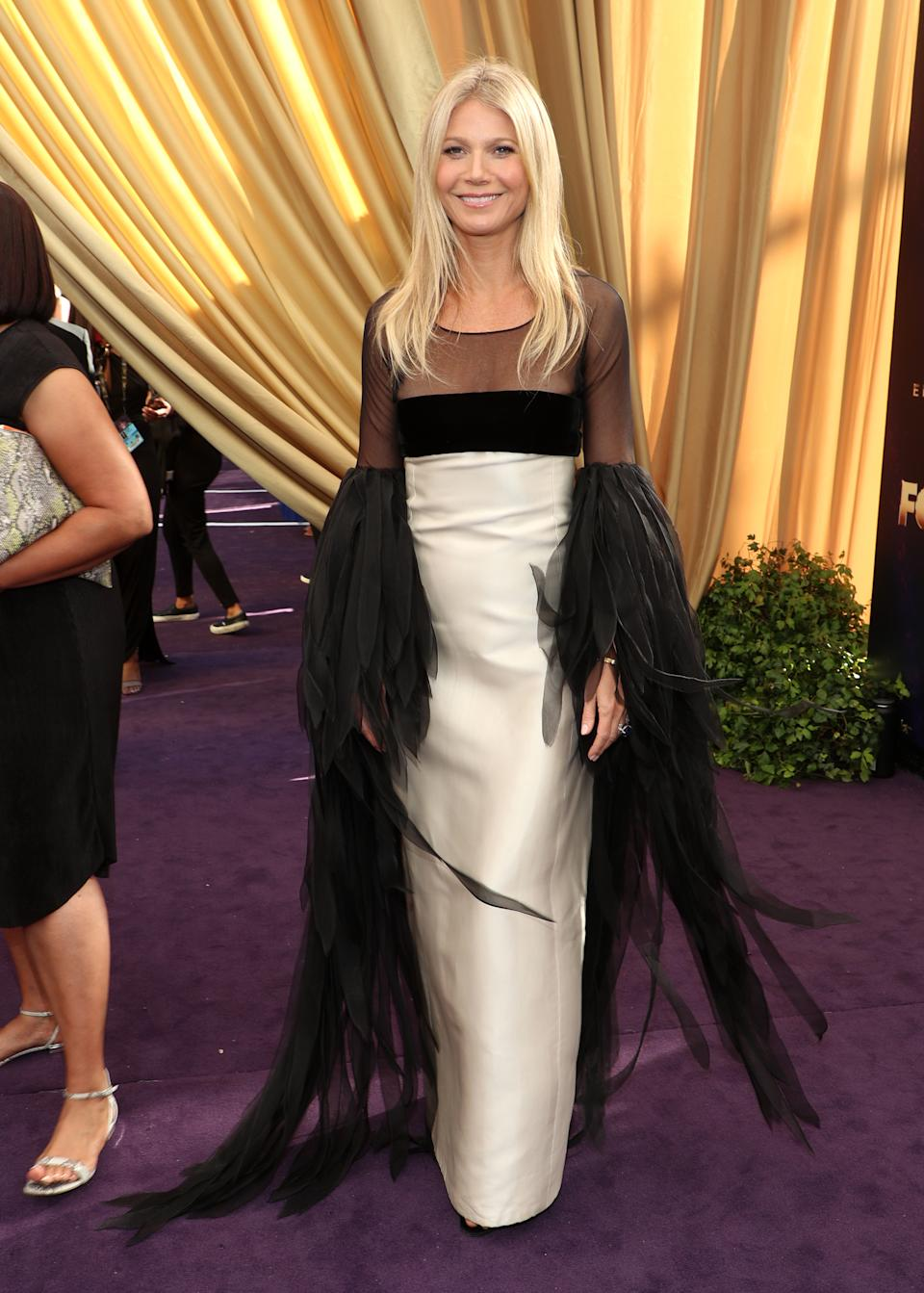 <p>In 2019, Gwyneth Paltrow hit the Emmys red carpet in a vintage 1963 Valentino look. The dramatic sleeves and stiff bodice and skirt were a fashion miss for fans and made for an awkward moment as Paltrow tried to walk across the Emmy stage. (Image via Getty Images)</p>