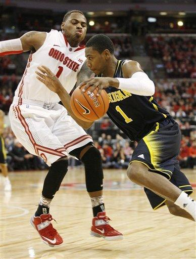 Ohio State's DeShaun Thomas, left, tries to slow down Michigan's Glenn Robinson III, right, during the second half of an NCAA college basketball game on Sunday, Jan. 13, 2013, in Columbus, Ohio. Ohio State won 56-53. (AP Photo/Mike Munden)