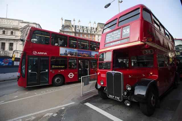 An old Routemaster double-decker bus (R), which had been decommissioned from regular service, carries commuters from Victoria Station whilst the London Underground runs a limited service due to industrial action on April 30, 2014 in London, England. (Photo by Oli Scarff/Getty Images)