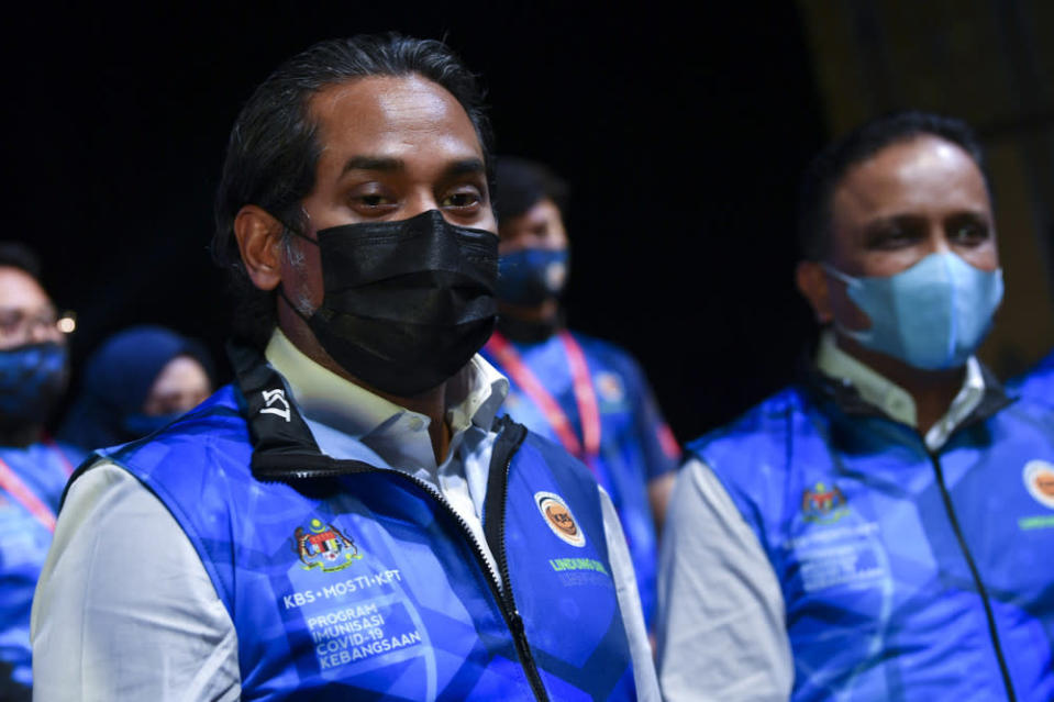 Khairy Jamaluddin and Datuk Seri Reezal Merican Naina Merican at a media conference at the Malaysia Vaccine Support Volunteers (MYVAC) duty assignment in Putrajaya, March 31, 2021. — Bernama pic