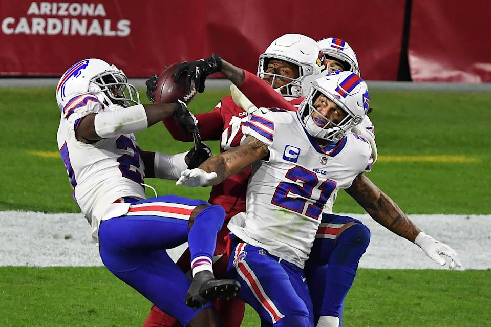 GLENDALE, ARIZONA - NOVEMBER 15: Wide receiver DeAndre Hopkins #10 of the Arizona Cardinals catches the game-winning touchdown pass as safety Jordan Poyer #21 and safety Micah Hyde #23 of the Buffalo Bills defend during the final seconds of the fourth quarter at State Farm Stadium on November 15, 2020 in Glendale, Arizona. (Photo by Norm Hall/Getty Images)