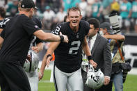 Las Vegas Raiders kicker Daniel Carlson (2) reacts while running off the field after the Las Vegas Raiders defeated the Miami Dolphins in overtime of an NFL football game, Sunday, Sept. 26, 2021, in Las Vegas. (AP Photo/Rick Scuteri)