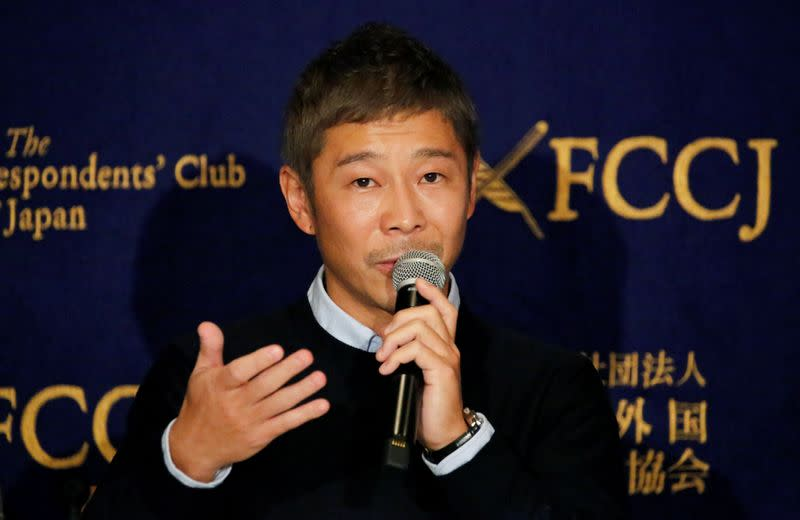 FILE PHOTO: Japanese billionaire Maezawa, founder and chief executive of online fashion retailer Zozo, who has been chosen as the first private passenger by SpaceX, attends a news conference in Tokyo