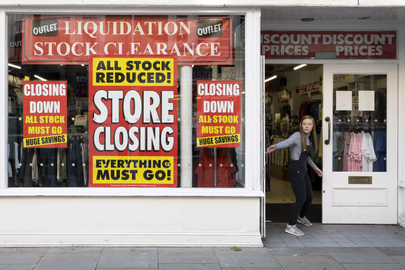 NEWPORT, WALES - SEPTEMBER 14: A shop worker closes the door of a shop that is shutting down on September 14, 2020 in Newport, Wales. First Minister of Wales Mark Drakeford has announced people in Wales must wear face mask in shops and other indoor public spaces from Monday. Indoor meetings of more than six from an extended household will be illegal from Monday. The rule will not apply to children under 11 and up to 30 people from different homes can still meet outside. (Photo by Matthew Horwood/Getty Images)