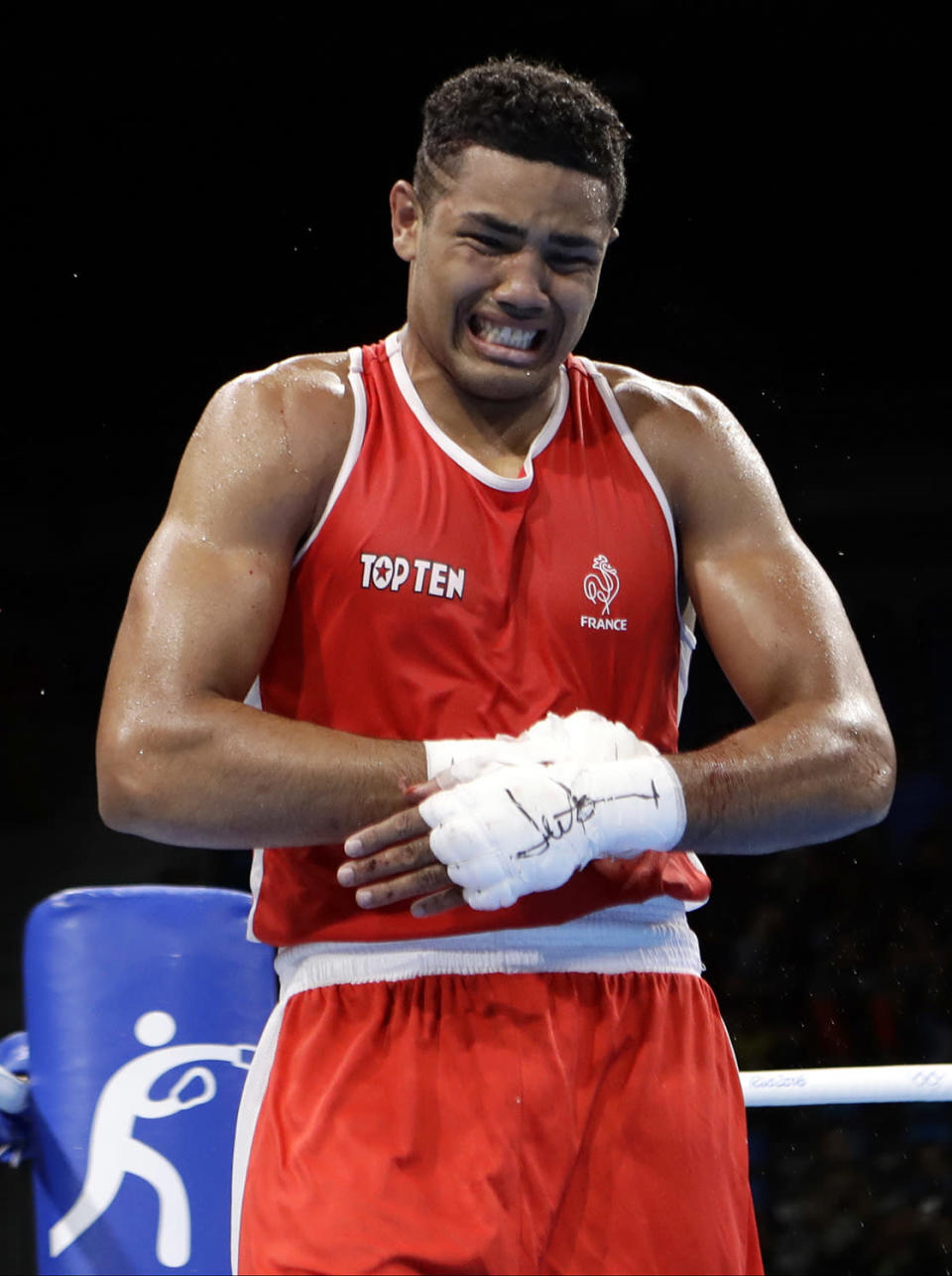 <p>France's Paul Omba Biongolo cries after losing a match against Azerbaijan's Abdullayev Abdulkadir during a men's heavyweight 91-kg preliminary boxing match at the 2016 Summer Olympics in Rio de Janeiro, Brazil, Monday, Aug. 8, 2016. (AP Photo/Frank Franklin II) </p>