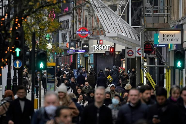 Shoppers head to London's Oxford Street on December 2, 2020 as England emerged from a month-long lockdown and the UK's independent medicines regulator gave a green light to the BioNTech-Pfizer drug