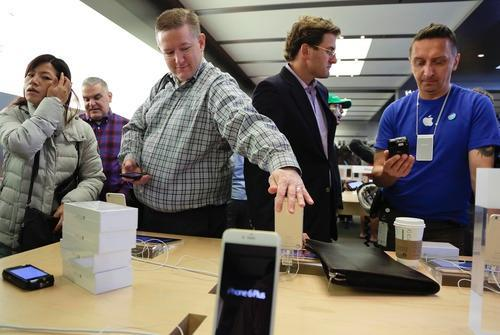 Customers in an Apple Store