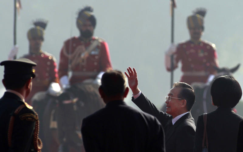 Chinese Premier Wen Jiabao, second right, waves during a ceremony at the Rashtrapati Bhavan, or the Presidential Palace, in New Delhi, India, Thursday, Dec. 16, 2010. During Wen's three-day visit to India, the two sides were expected to discuss their lingering border disputes, a growing trade imbalance and friction over India's role in Kashmir, the restive region that is also claimed by India's arch rival, Pakistan. (AP Photo/Kevin Frayer)