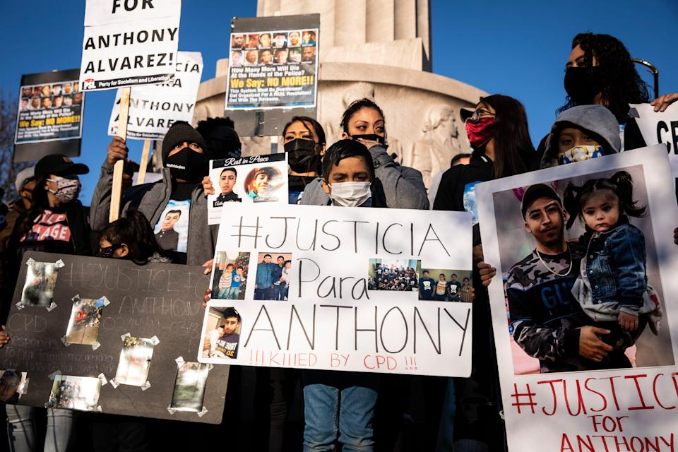 More than a thousand people gather in front of the Logan Square Monument to protest the fatal shooting by Chicago police of 13-year-old Adam Toledo, Friday, April 16, 2021 in Chicago.