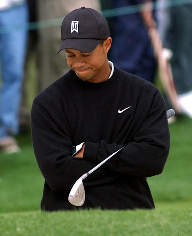 <p>Defending champion Tiger Woods contemplates his shot before hitting from the bunker on the 2nd hole during first round play of the 2003 Masters at the Augusta National Golf Club in Augusta, Ga., Friday, April 11, 2003. (AP Photo/Elise Amendola) </p>