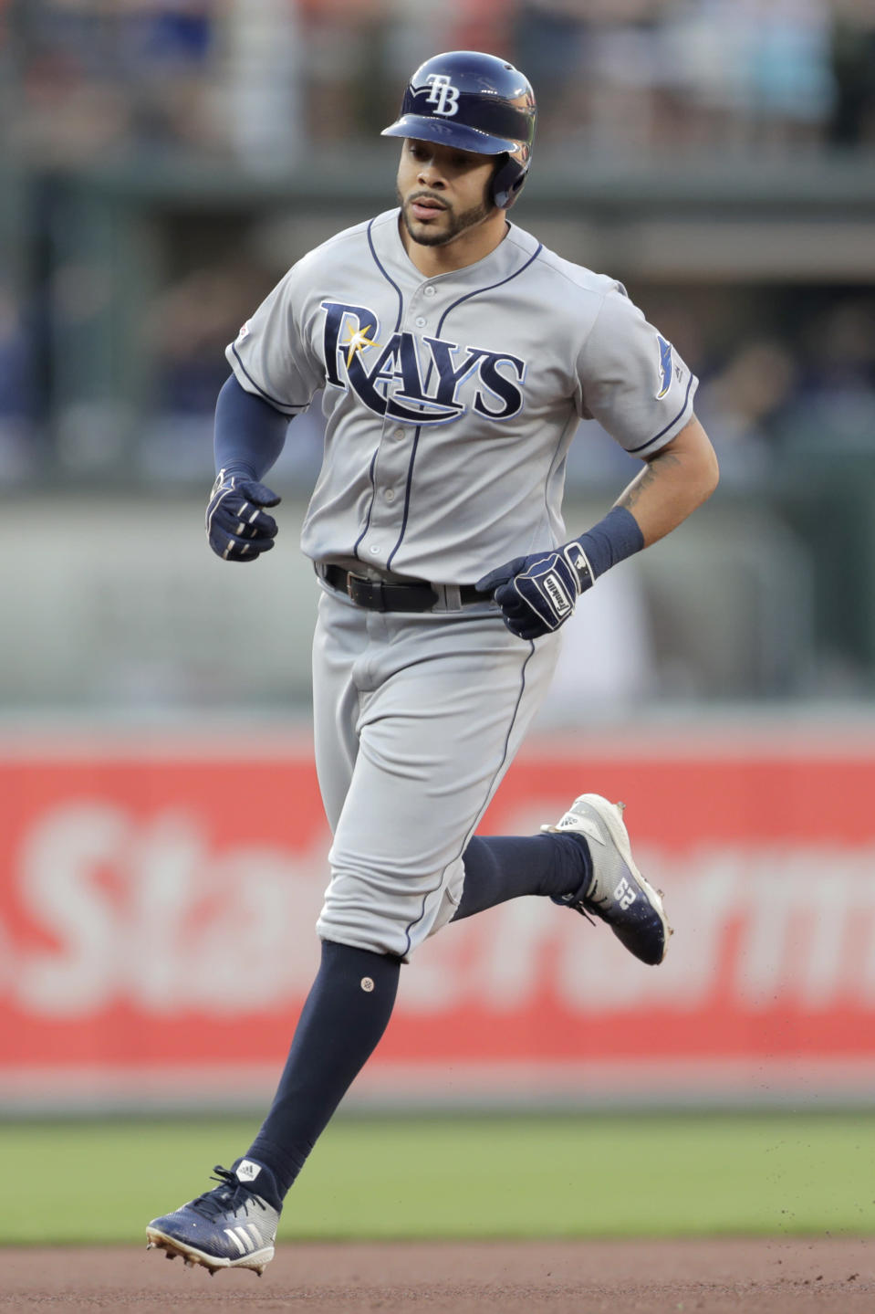 Tampa Bay Rays' Tommy Pham runs the bases after hitting a solo home run off Baltimore Orioles starting pitcher Dylan Bundy during the first inning of a baseball game Friday, July 12, 2019, in Baltimore. (AP Photo/Julio Cortez)
