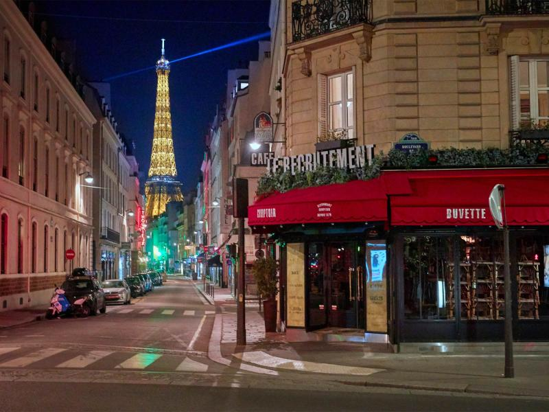 Closed bars and cafes pictured on empty streets on the first night of the Coronavirus curfew on October 17, 2020 in ParisGetty Images