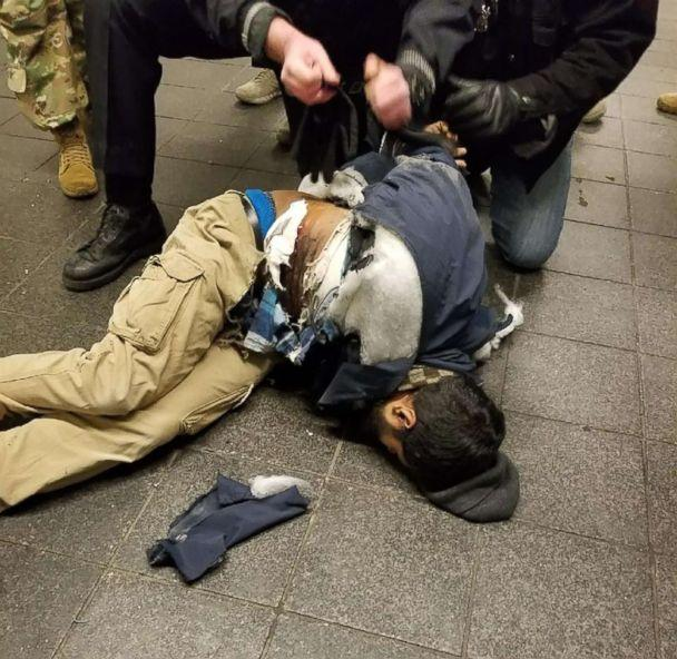 PHOTO: Police take down Akayed Ullah in New York in a photo widely shared on social media, Dec. 11, 2017. (Obtained by ABC News)