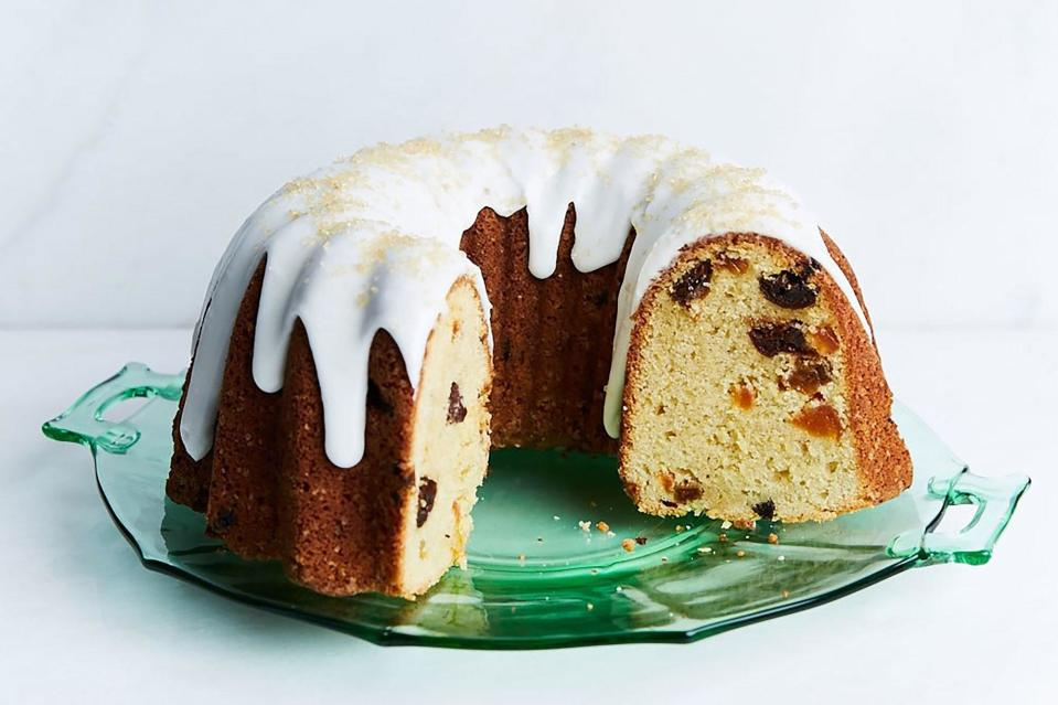 """Rum-soaked fruit is suspended throughout the batter of this bundt cake, which also gets a luscious sour cream glaze. <a href=""""https://www.epicurious.com/recipes/food/views/fruity-rum-bundt-cake?mbid=synd_yahoo_rss"""" rel=""""nofollow noopener"""" target=""""_blank"""" data-ylk=""""slk:See recipe."""" class=""""link rapid-noclick-resp"""">See recipe.</a>"""
