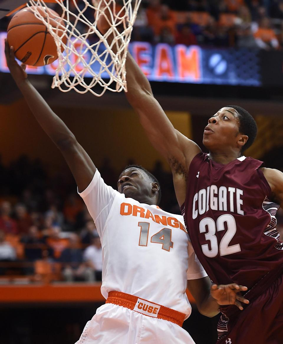 Syracuse's Kaleb Joseph drives to the basket against Colgate's Jordan Robertson during the second half of an NCAA college basketball game in Syracuse, N.Y., Monday, Dec. 22, 2014. (AP Photo/Kevin Rivoli)