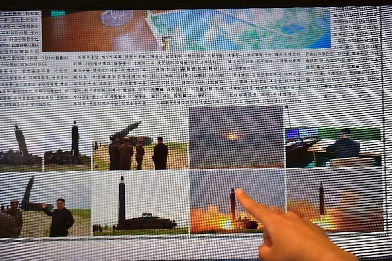 North Korean newspapers on June 23, 2016 display stories and images about the Musudan missile tests (AFP Photo/Jung Yeon-Je)