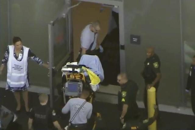 <p>A man placed in handcuffs by police is wheeled on a stretcher into a hospital near Marjory Stoneman Douglas High School following a shooting incident in Parkland, Fla. on Feb. 14, 2018 in a still image taken from a video. (Photo: WSVN.com via Reuters) </p>