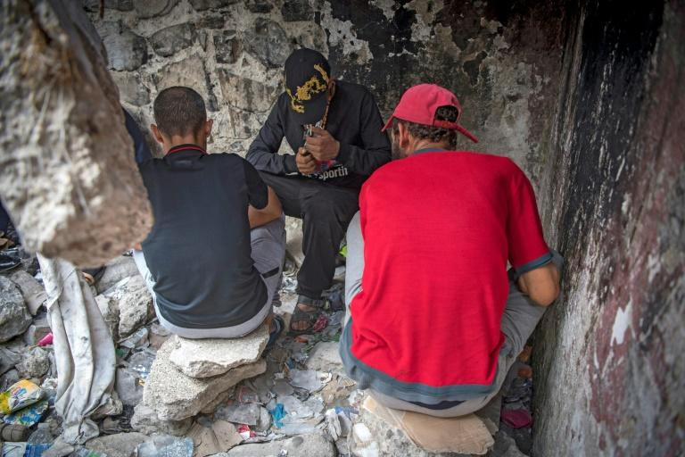 Moroccan addicts smoke heroin in a squat behind a police station in the Moroccan city of M'diq near Tetouan (AFP Photo/FADEL SENNA)