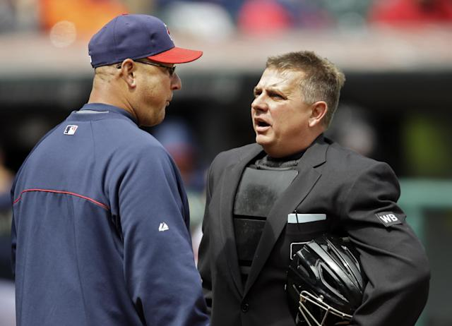 Cleveland Indians manager Terry Francona, left, questions home plate umpire Greg Gibson on a play at the plate in the first inning of a baseball game between the Indians and Kansas City Royals Thursday, April 24, 2014, in Cleveland. Gibson's out call on Indians' Asdrubal Cabrera was confirmed after a crew challenge. (AP Photo/Mark Duncan)