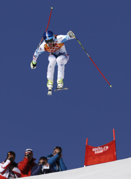 Austria's Matthias Mayer makes a jump during a men's downhill training run for the Sochi 2014 Winter Olympics, Friday, Feb. 7, 2014, in Krasnaya Polyana, Russia. (AP Photo/Luca Bruno)