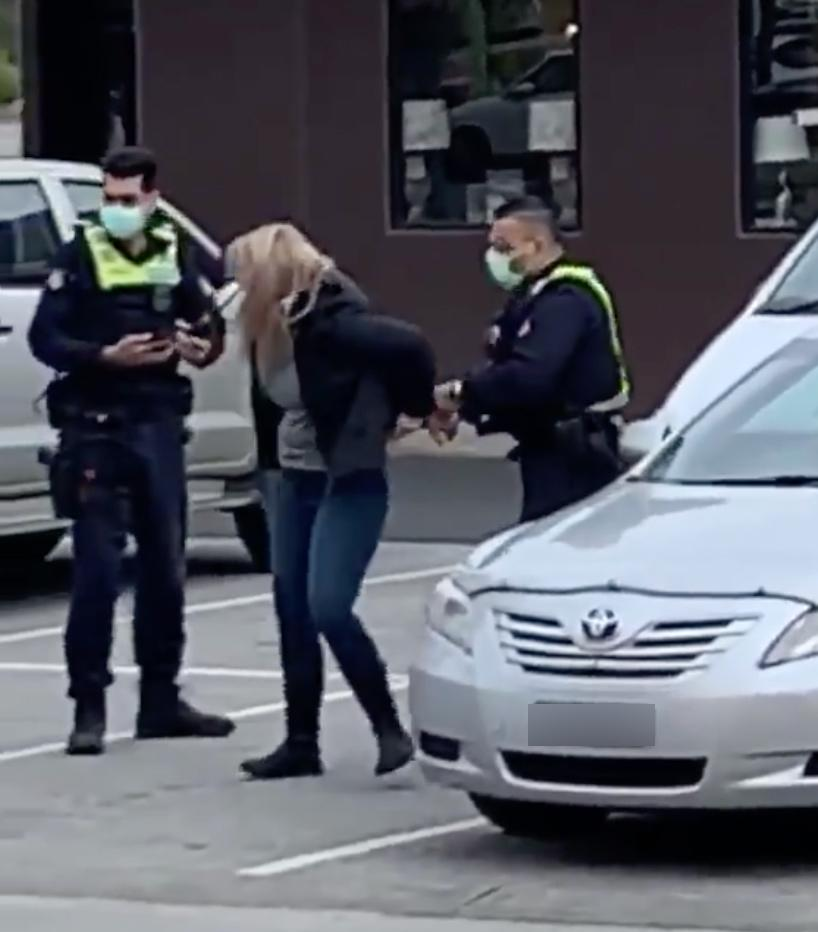 This woman was filmed being arrested after a confrontation with police. Source: Twitter