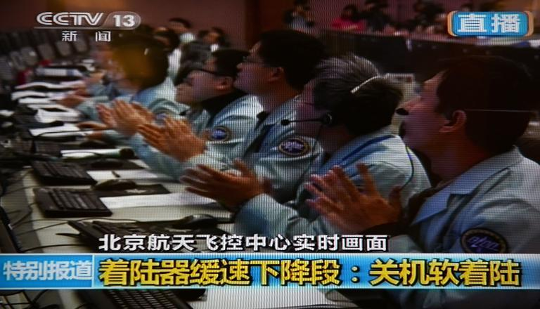 CCTV broadcasting footage shows scientists celebrating at the control centre in Beijing after China's first lunar rover landed on the moon on December 14, 2013