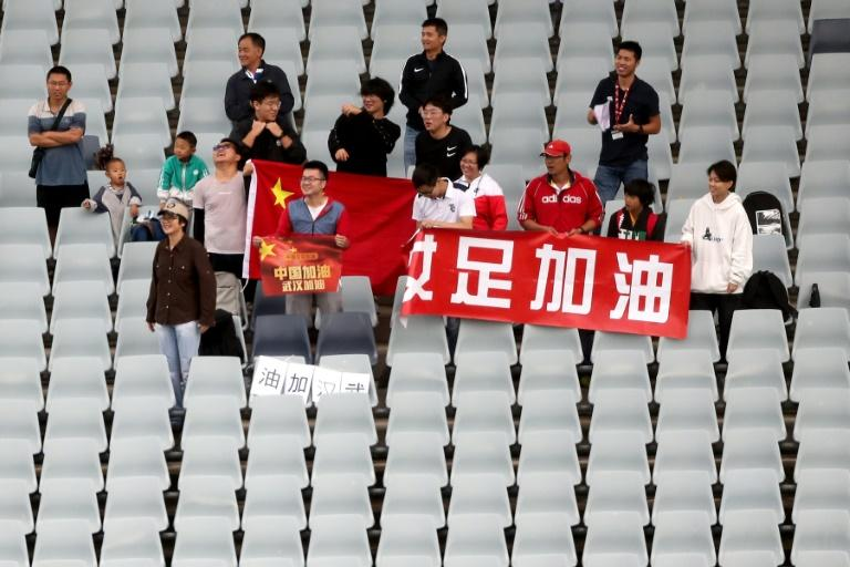 Chinese fans held a message of support for Wuhan during a women's Olympic football qualifier in Sydney