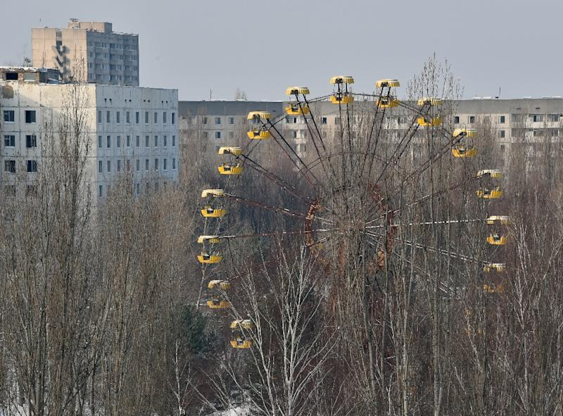 A ferris wheel and abandoned buildings in the ghost city Pripyat near to Chernobyl Power Plant (AFP Photo/Genya Savilov)