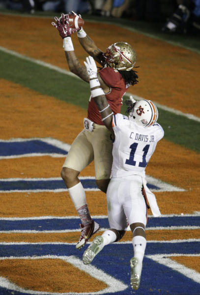 Florida State's Kelvin Benjamin catches a touchdown pass in front of Auburn's Chris Davis during the second half of the NCAA BCS National Championship college football game Monday, Jan. 6, 2014, in Pasadena, Calif. (AP Photo/Gregory Bull)