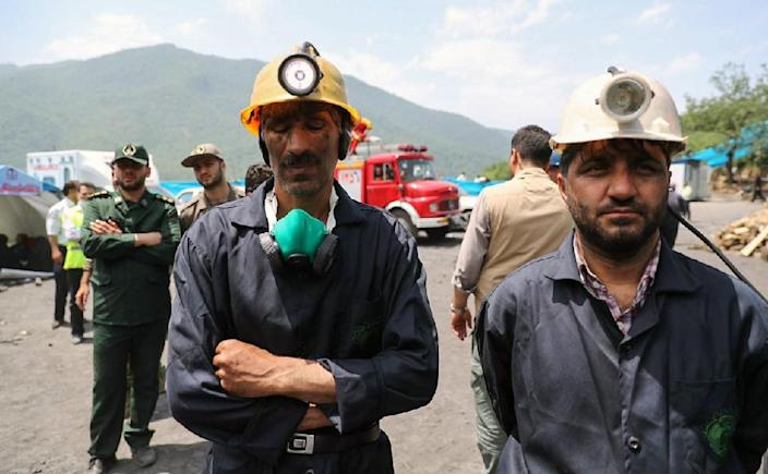 A handout picture provided by the office of Iranian President Hassan Rouhani on May 7, 2017 shows coal miners and rescue workers standing at the scene of a coal mine which suffered from an explosion in Azadshahr, in northern Iran (AFP Photo/HO)