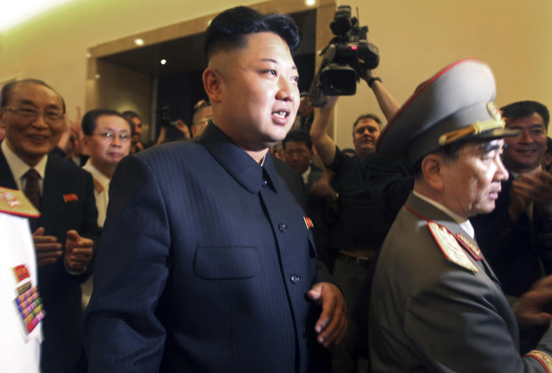 North Korean leader Kim Jong Un, center, flanked by Yang Hyong Sop, left, vice president of the Presidium of North Korea's parliament, tours the newly opened Fatherland Liberation War Museum, Saturday, July 27, 2013 as part of celebrations for the 60th anniversary of the Korean War armistice in Pyongyang, North Korea.(AP Photo/Wong Maye-E)