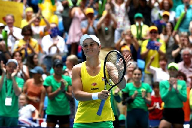 Ashleigh Barty of Australia kept her cool to embarrass a stunned Caroline Garcia (AFP Photo/Tony ASHBY)
